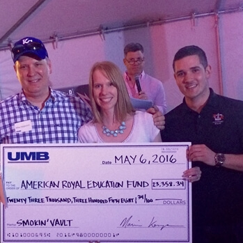 Left to right: Mike Hagedorn, President and CEO, UMB Bank presents a check to Lynn Parman and Eric Pew.